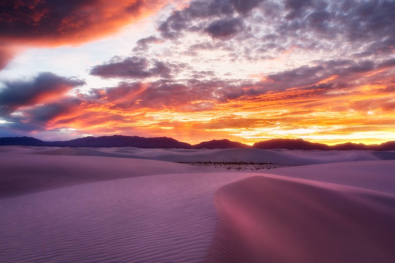 A Benro .6 soft grad filter was placed just above the mountains and horizon for this image. This helped balance out the intense light in the sky with the soft glow of the sand dunes. - White Sands National Monument, New Mexico