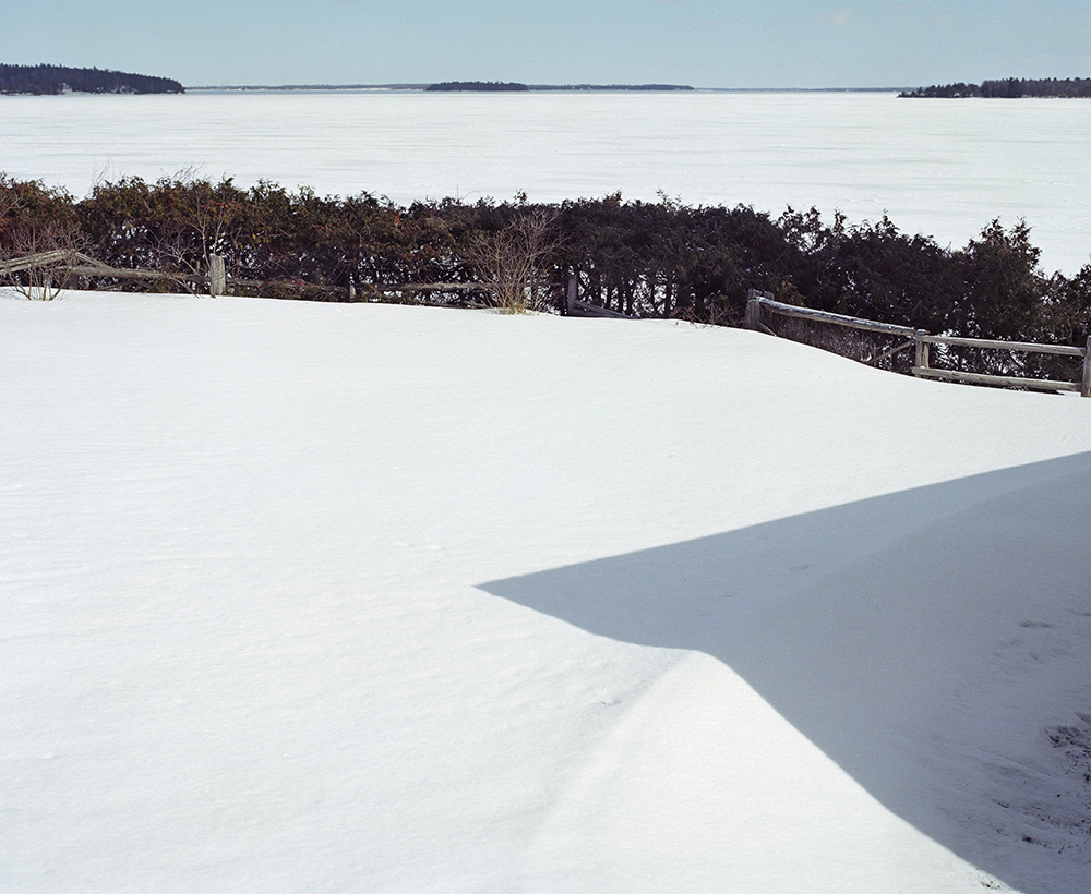 "29. Untitled (shadow snow and lake). Inkjet print. 20 X 16"". 2014."