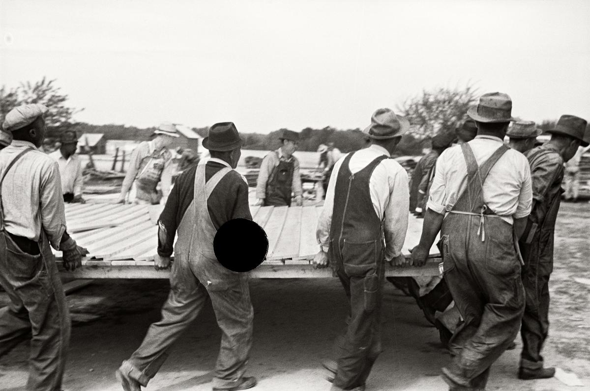 69. Loading wall of prefabricated house onto truck, Roanoke Farms, North Carolina. 1938. John Vachon. 8a03103