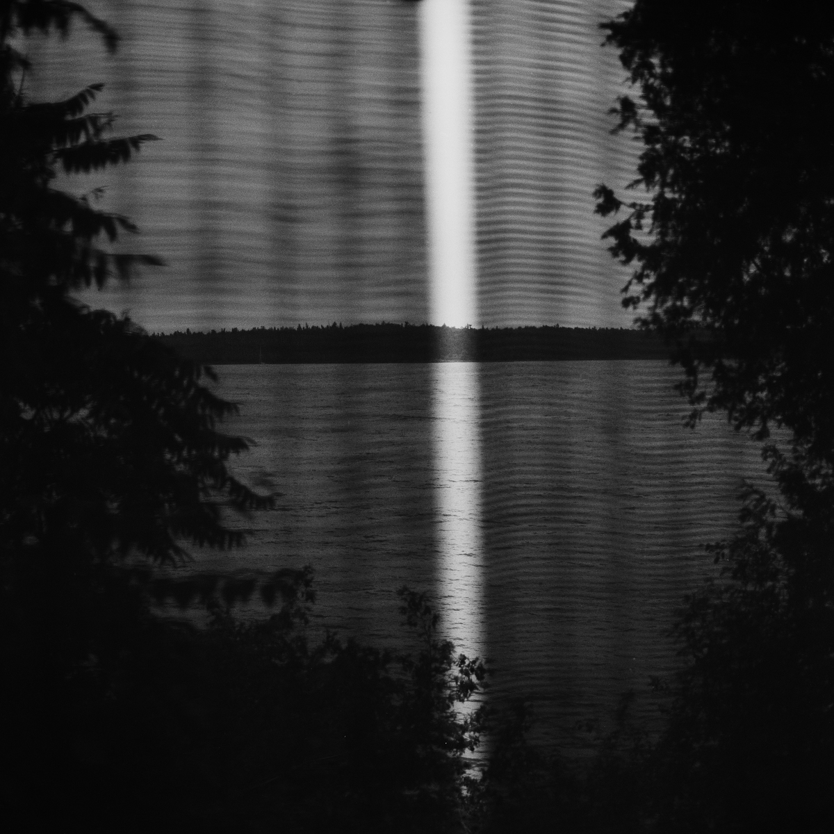 24. Window Louvers and Lake Champlain, Valcour, NY. 2001. Toned Gelatin Silver Print.