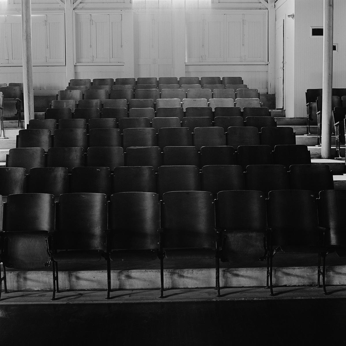 "16. Auditorium Seats. Lily Dale. 1996. Toned Gelatin Silver Print. 15""X15""."