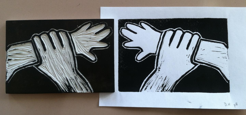 Back of the Yards High School Print Workshop.   Printing block and print.