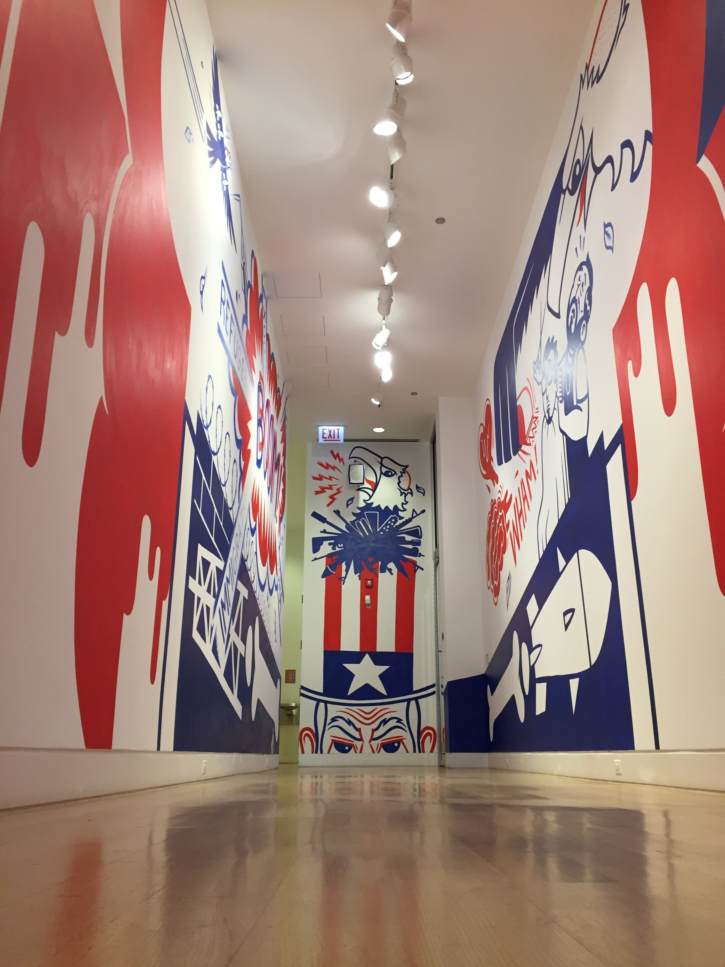 The Bald Eagle's Toupee   Three wall mural: H15'xW33.99', 15'x33.9', & 15'x9'' gallery space, and audio recording by Mike Garcia. Animations by Luis Mayorga. Installation at the DePaul Art Museum. Chicago IL