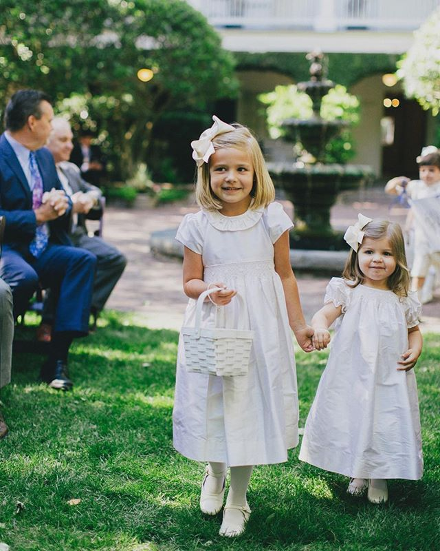 The sweetest of flower girls there ever were! 🌸 Who else just adores the tiniest of wedding party guests?! 👧🏼💕📷 by @manorstudios1848