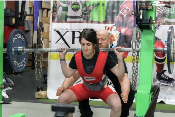 Squatting at the RPS Barno-Newman Classic in February 2018. My first powerlifting meet!