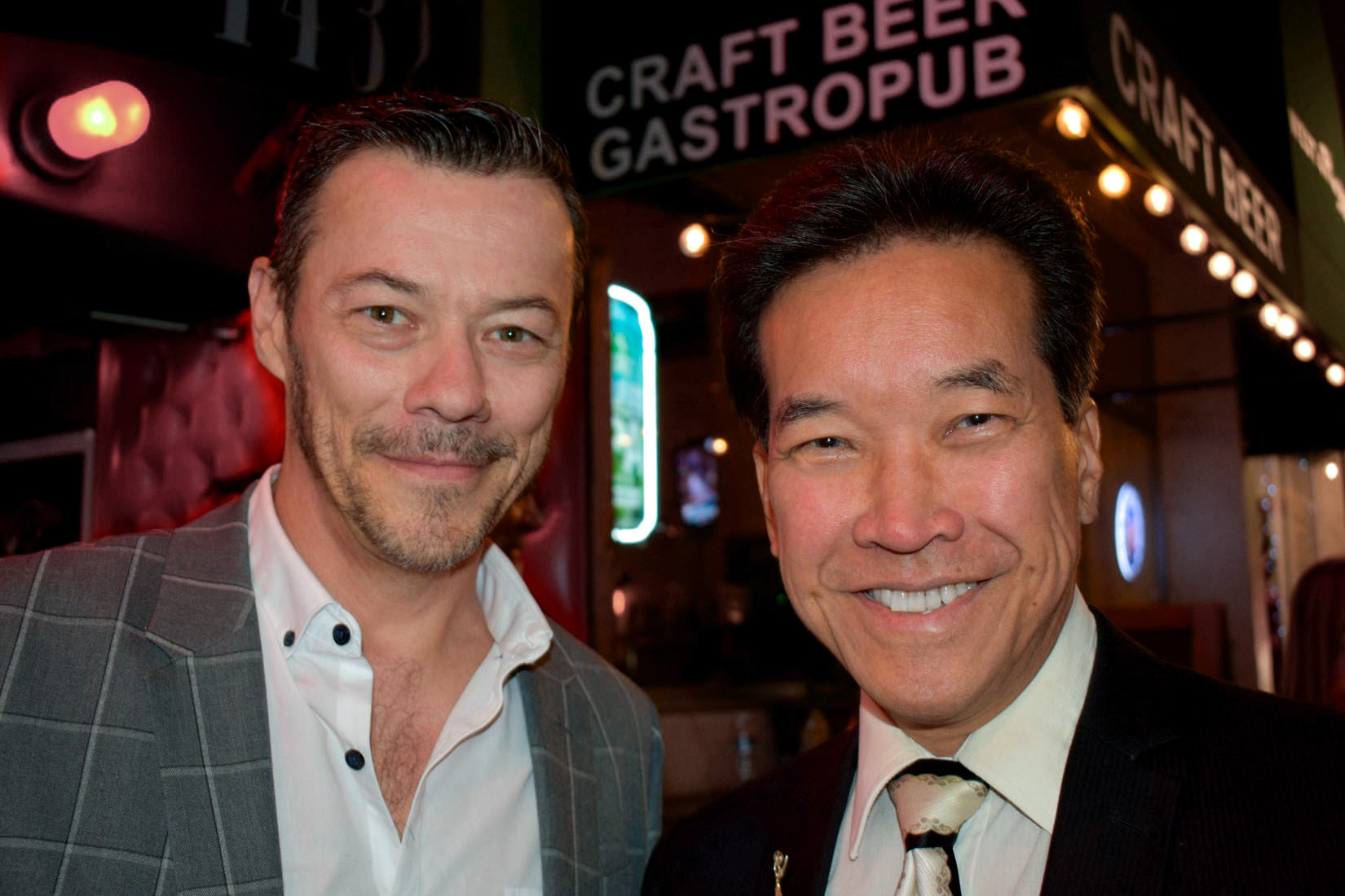 Actors Massi Furlan and Peter Kwong enjoy a night of talent in support of the Bring Hollywood Home Benefit.