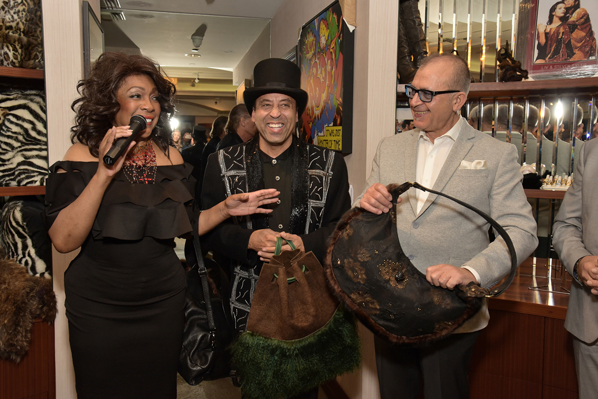 Mary Wilson, Sir Keith Holman and designer Fabrizio Pasquale present the Re-Fur-Bished Collection.