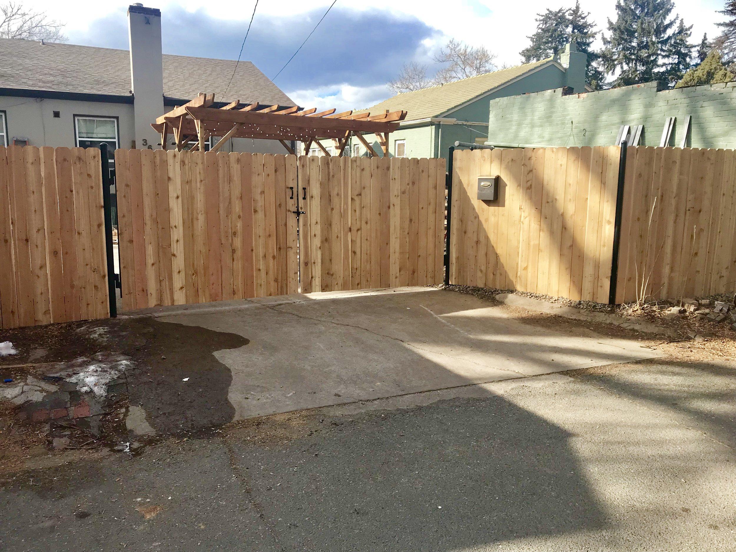 Double swing gate - Vertical cedar on top of steel frame/post