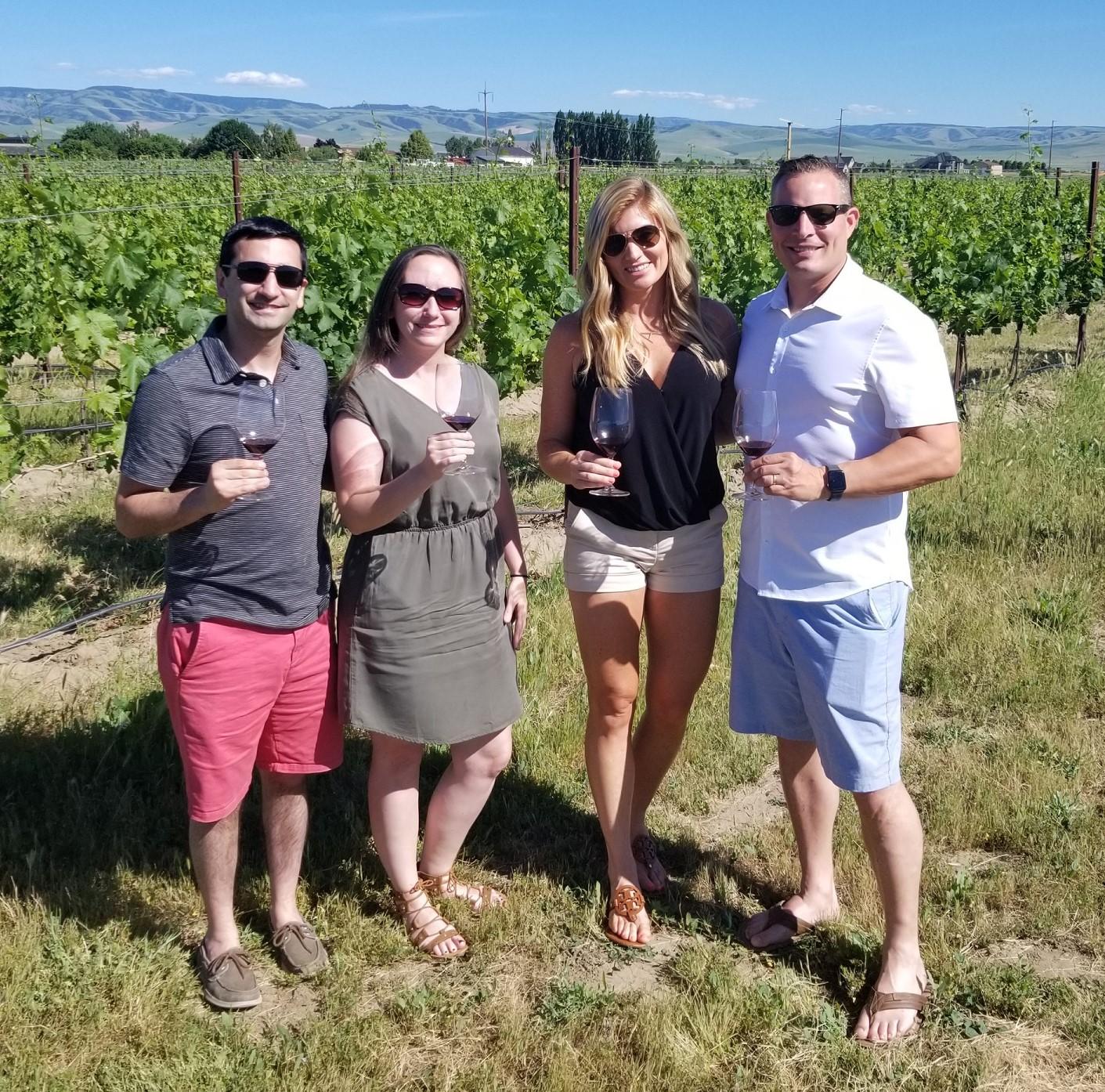 Group wine tasting in vineyard in Walla Walla