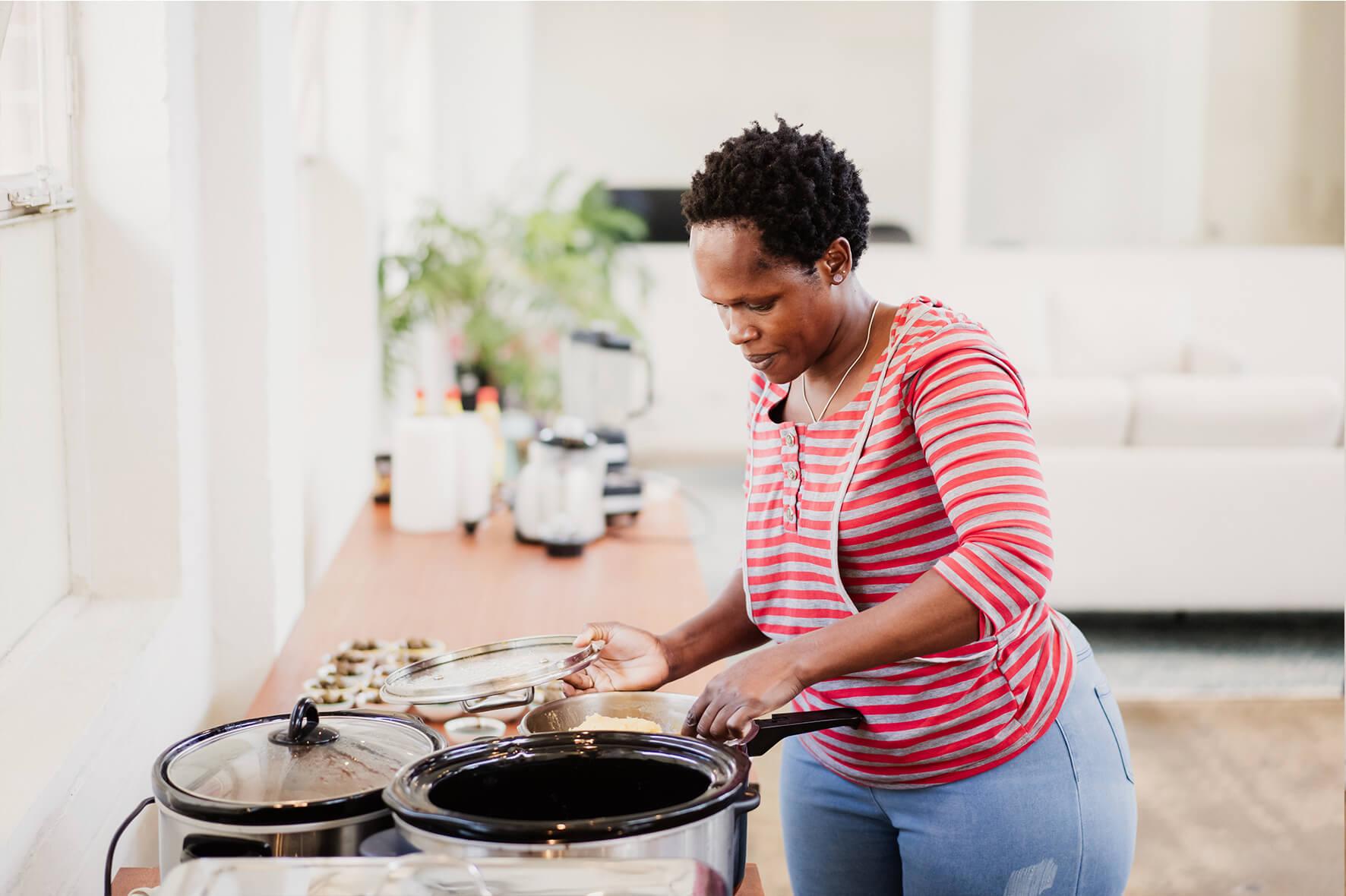 AmazingCo Refugee Degustation - Perus (Uganda) prepares her dish.jpg