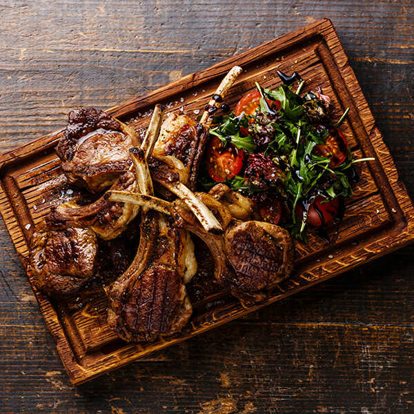 Mystery Food Walks - Lamb cutlets on a wooden board.jpg