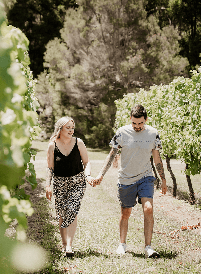 James and Kerrie walking among vines.png