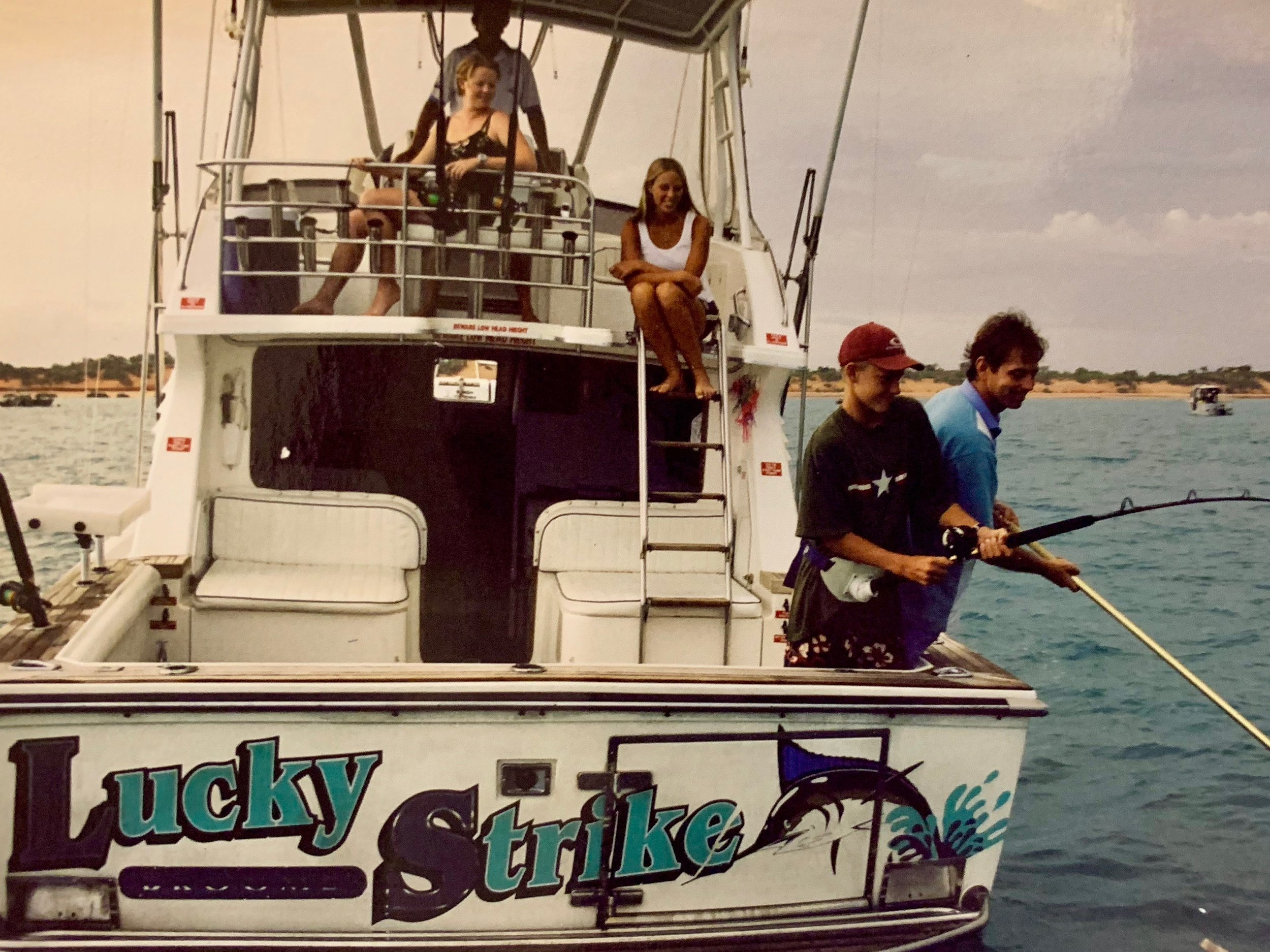 Age 14, fishing with dad and Liss (sister)