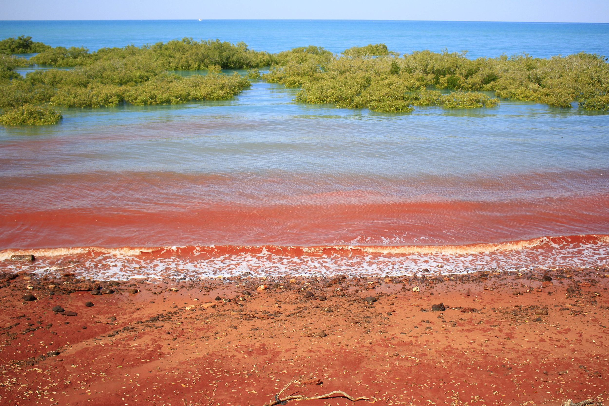 Red 'pindan' soil leaching into the sea on high tide