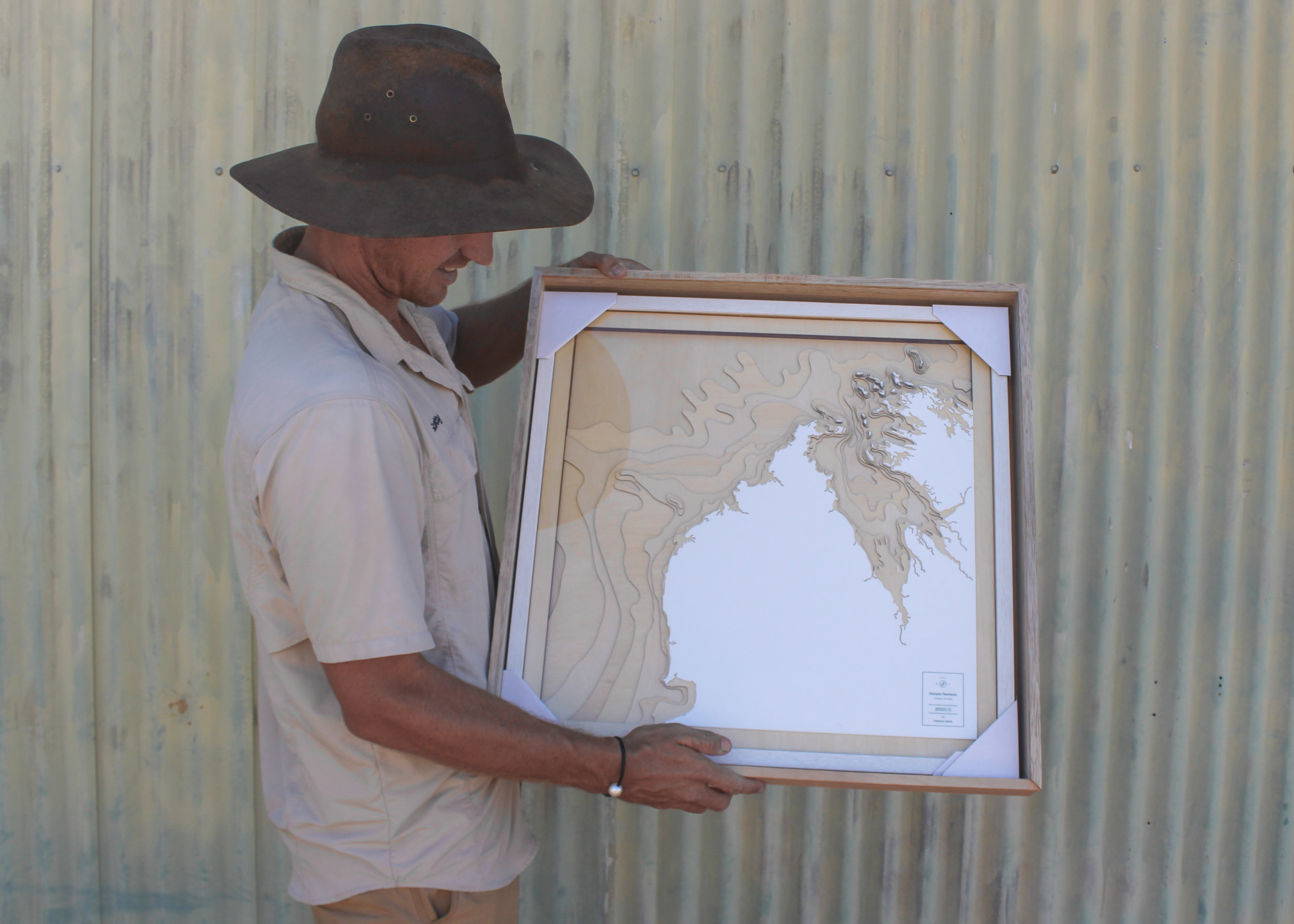 Scotty (our book's author) holding the  Pangea map  that we're giving away.