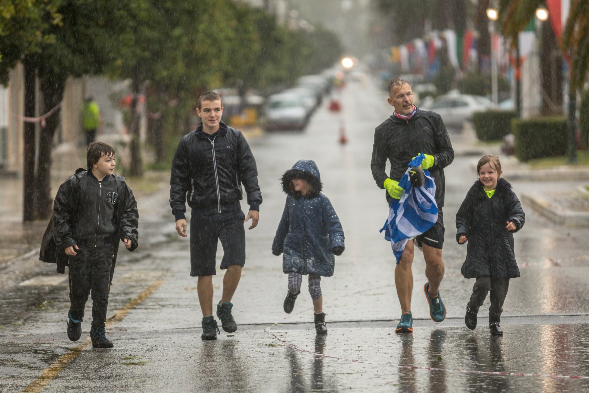 James bringing home #fourinarow with twin daughters and nephews - a special moment.  Photo Credit - Chris Mills