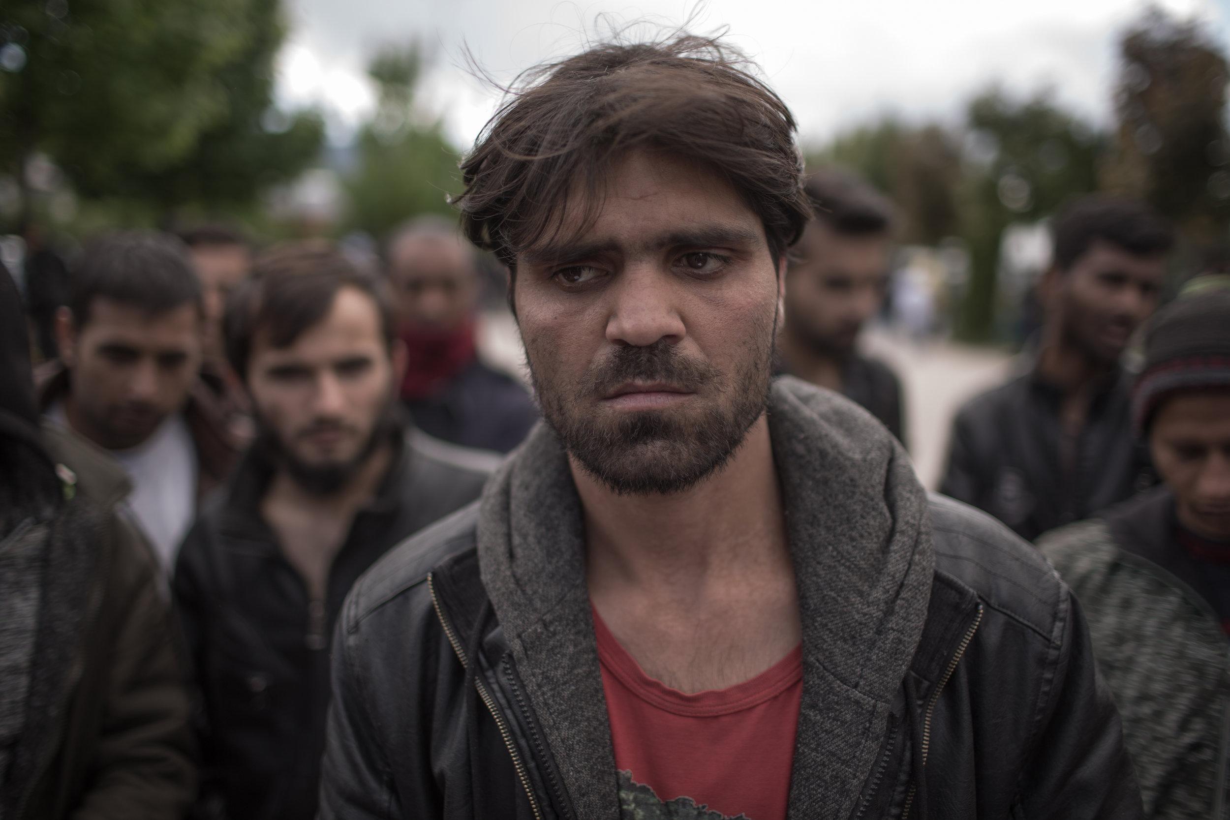 A migrant from Afghanistan in front of migrant center Bira in Bihać, BiH.