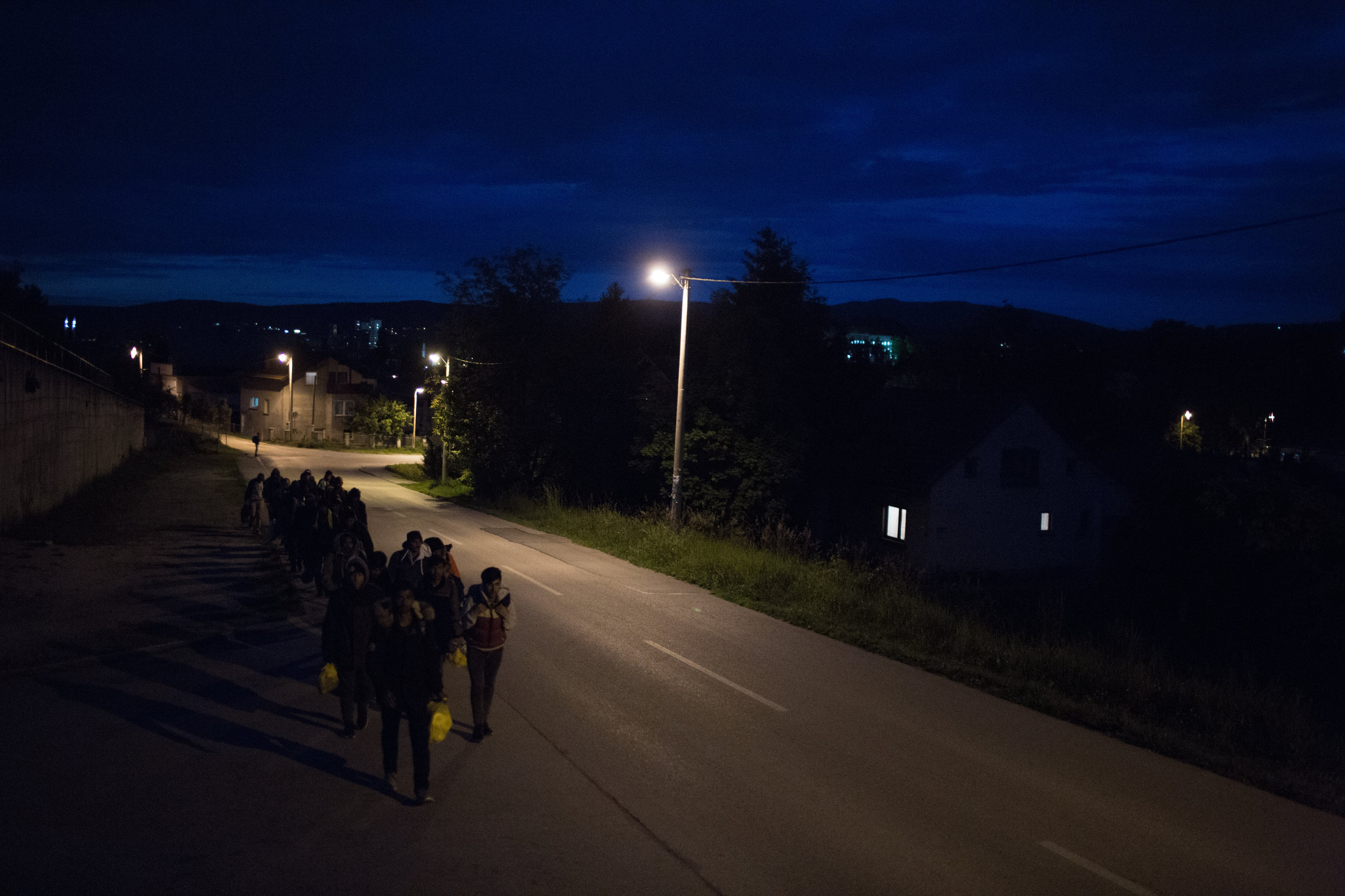 A group of migrants on a night walk near Zavalje in BiH towards Croatia.