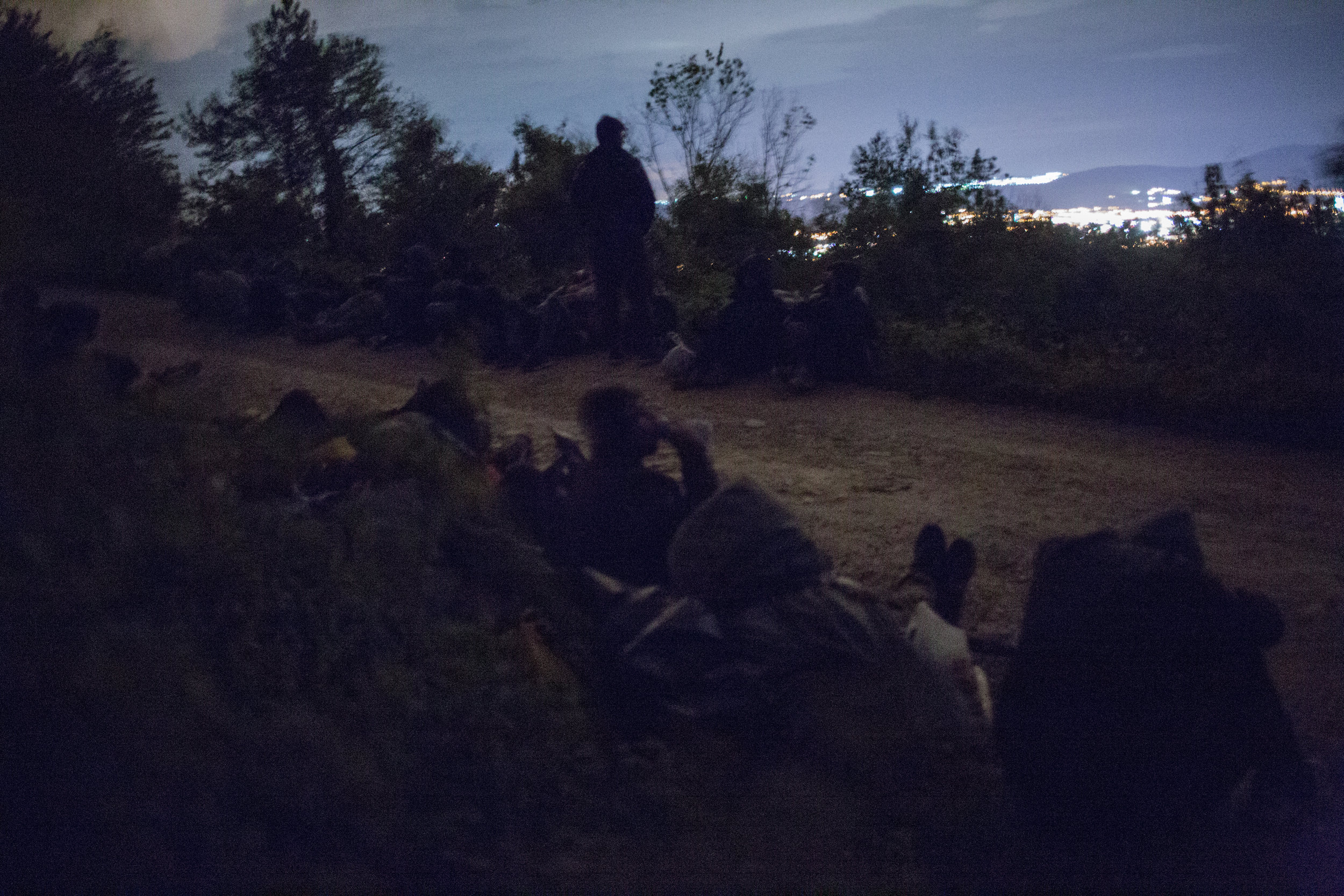 A group of refugees on a night walk near Zavalje in BiH towards Croatian border. For the most part, to avoid encountering police officers and residents, they choose less popular roads and places. The night shelters them from unwanted views.