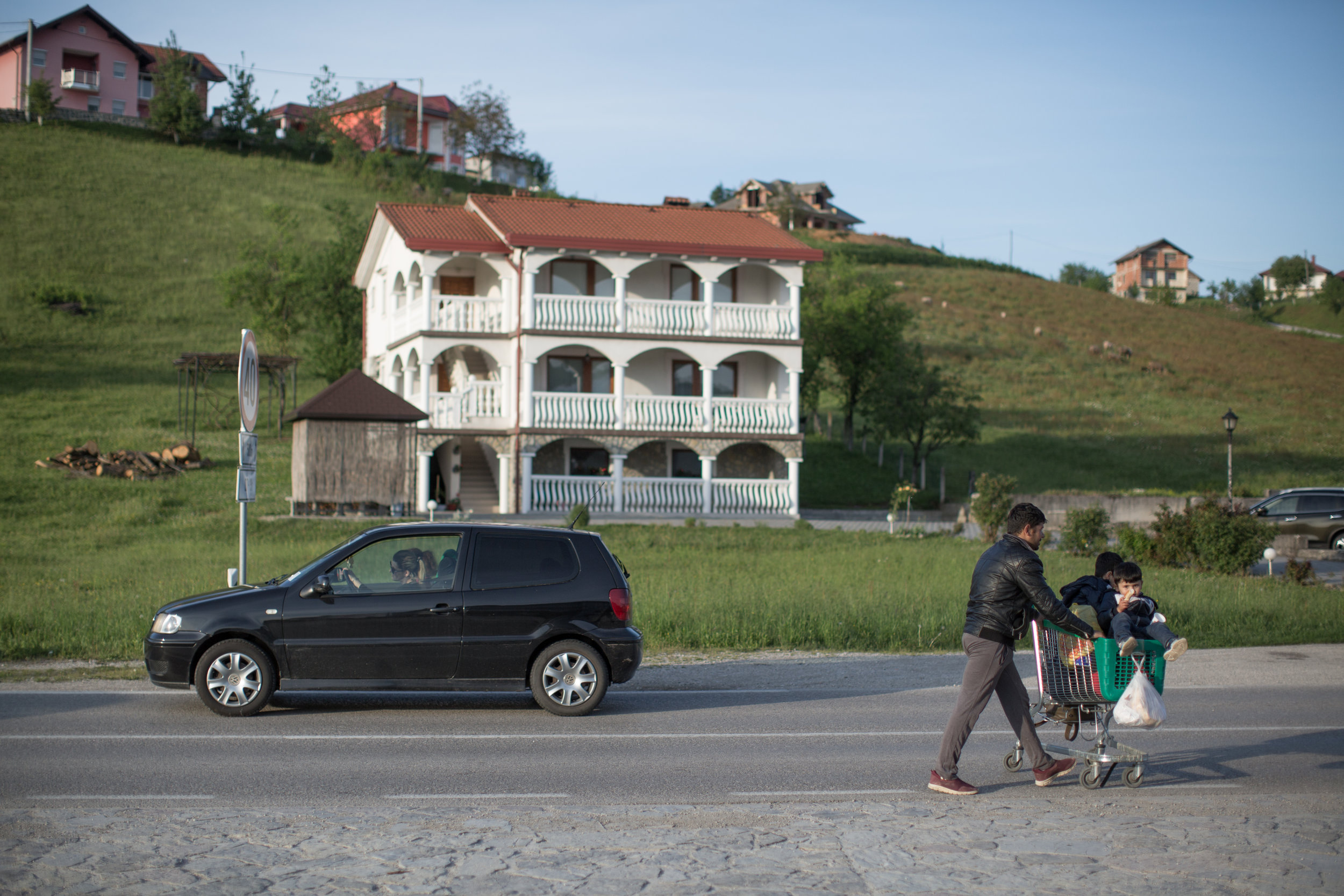 A family from Syria on their way to the migrant center Miral, Velika Kladuša, BiH.