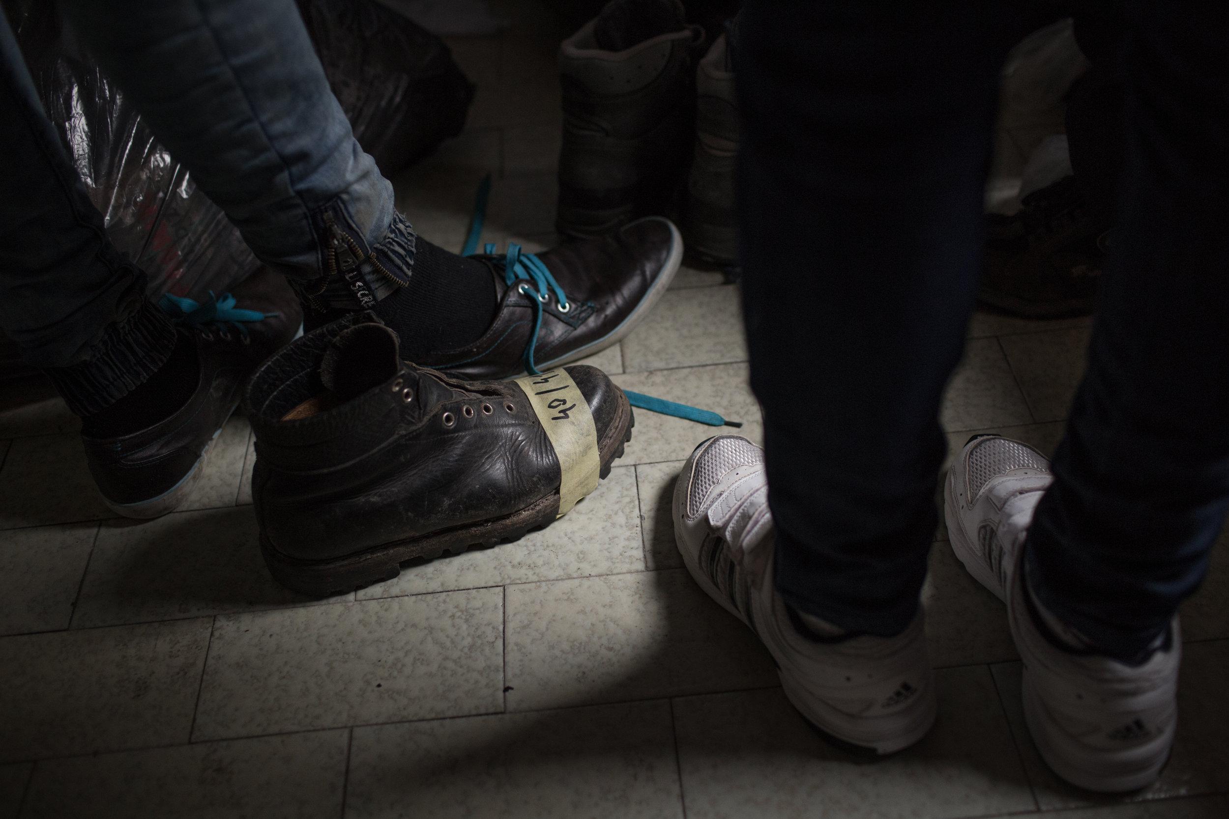 NGOs give migrants dry and clean clothing and footwear, Velika Kladuša, BiH.