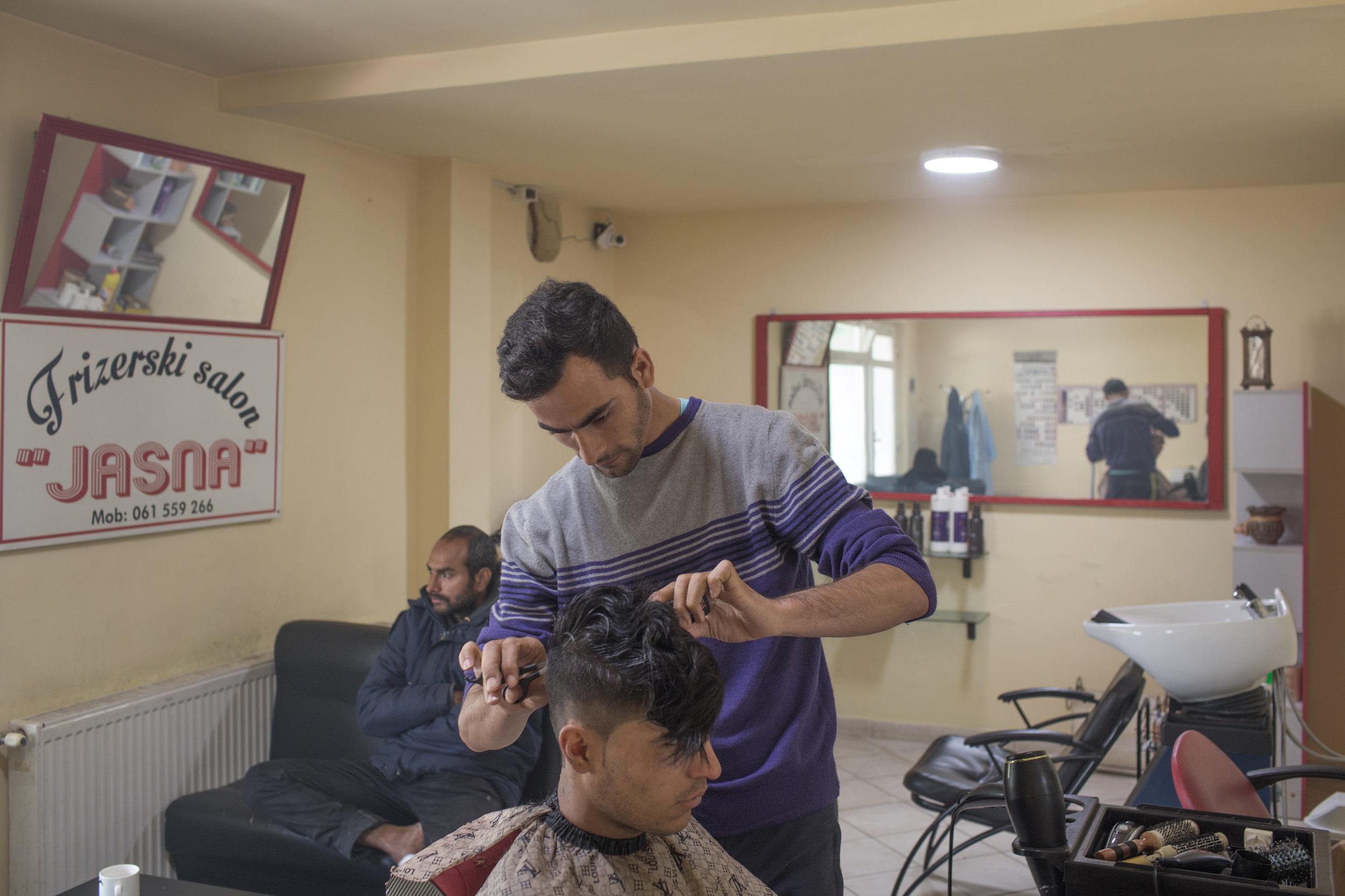 Tarik from Tunis is helping at the local hairdresser, Velika Kladuša, BiH.