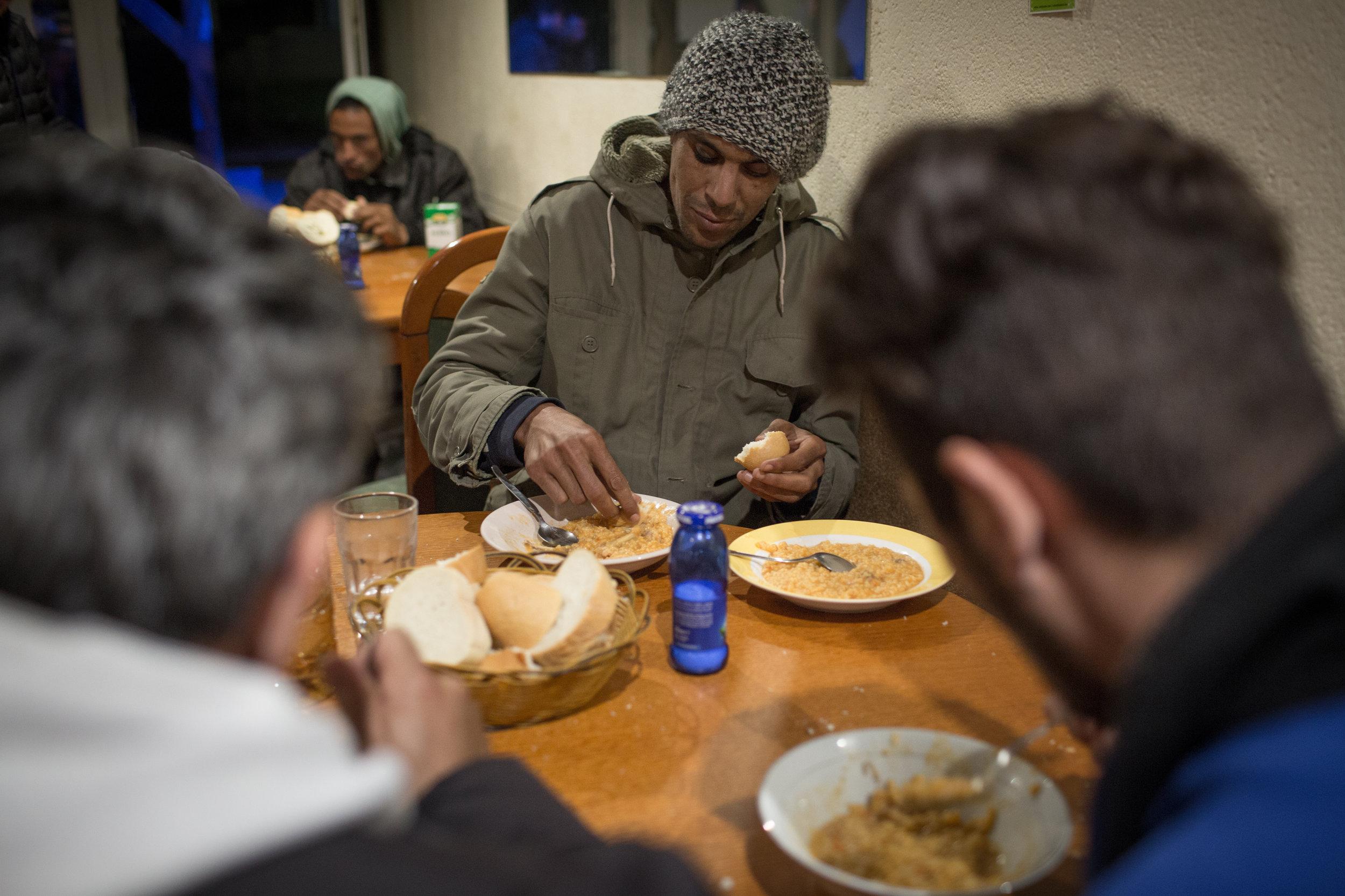 Migrants in the dining room of the former pizzeria, Velika Kladuša, BiH.