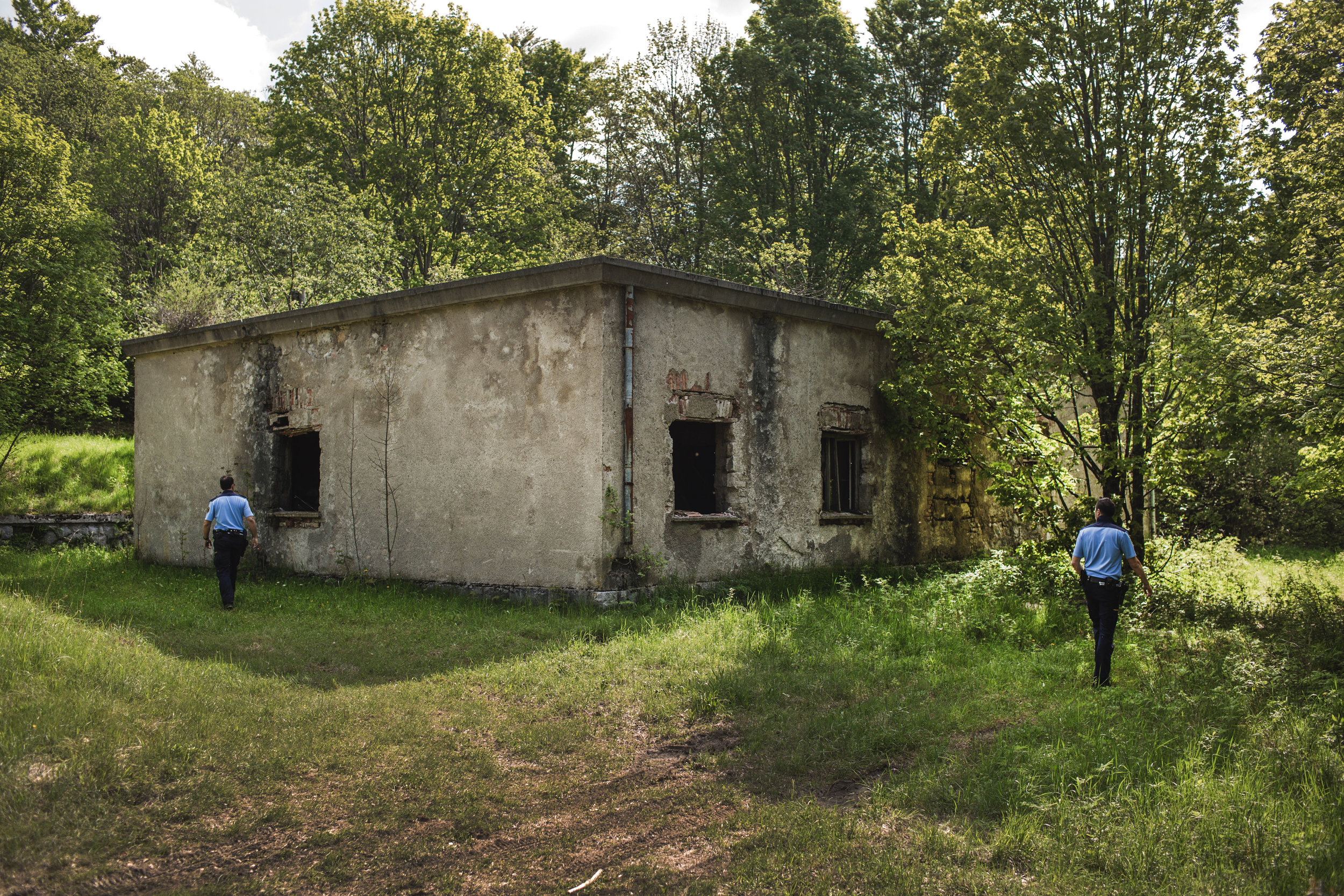 Slovenian police inspect an abandoned house in a forest at the border between Slovenia and Croatia, near town Ilirska Bistrica, Slovenia.