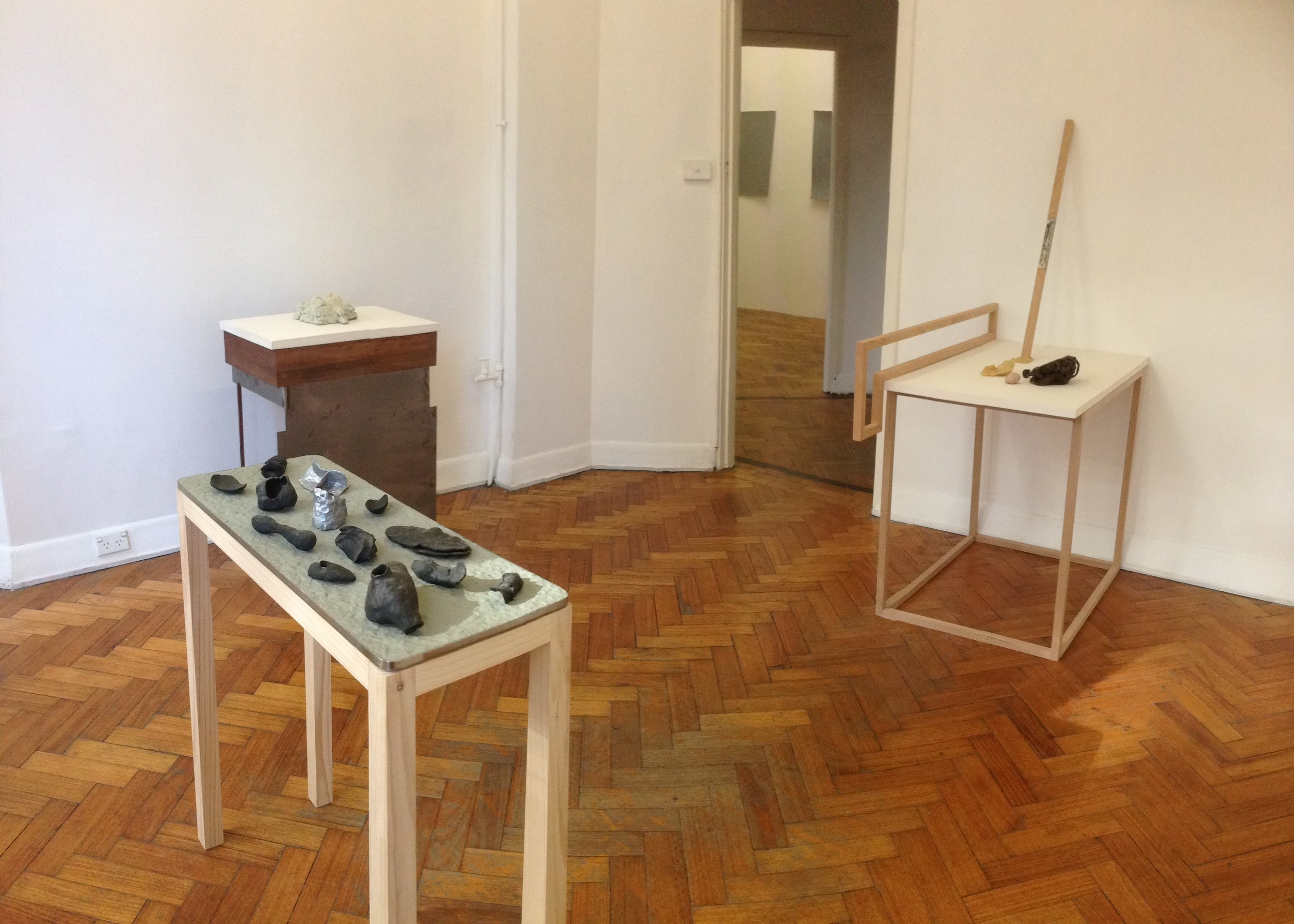 Table objects    entrance object,  cast bronze, cast aluminium, plasticine, stainless steel, wood 87 x 75 x 30cm;  bedroom object,  cast bronze, steel, wood, plaster, plasticine 97 x 61 x 41cm;  laundry objects , timber, cast steel, plaster, wool, wax, size variable.