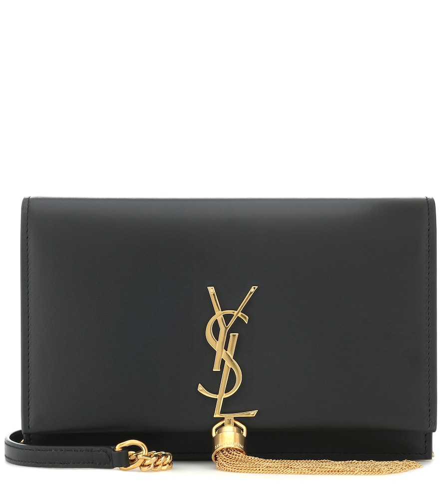 """Crafted in Italy from smooth """"Algae"""" green calf leather, Saint Laurent's Kate Tassel crossbody bag features a wallet-style interior with card slots for organization."""