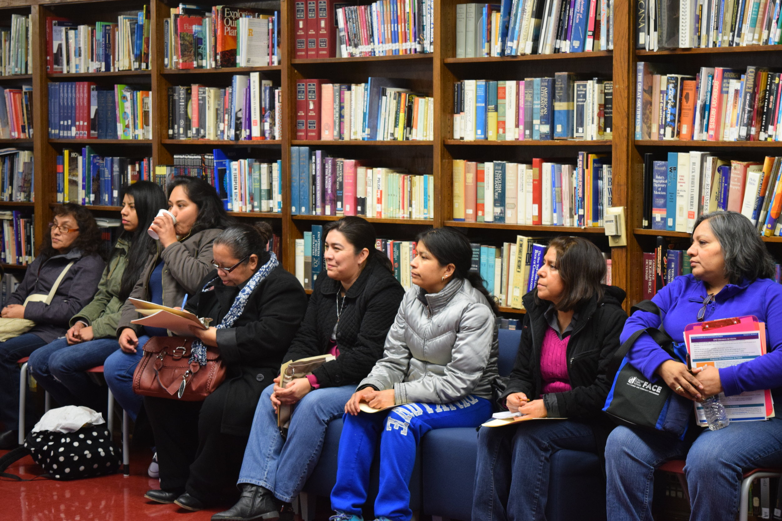 2017 PARENT FOCUS GROUP.  Parents gather in a school library to share their experiences with the Chicago school enrollment process.