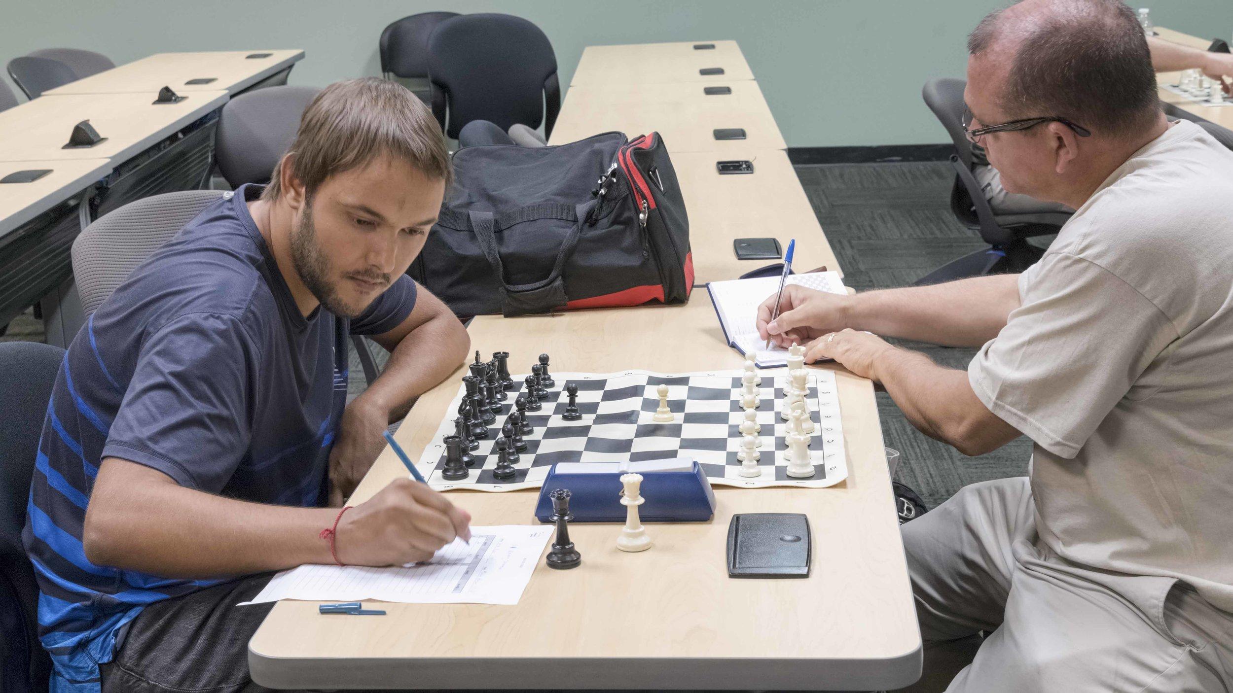 Round 1, inaugural Orlando Chess Club 4-week G75;d5 tournament with Martin Hansen (L) (2212) vs Carlos Rivas (R) (1721)