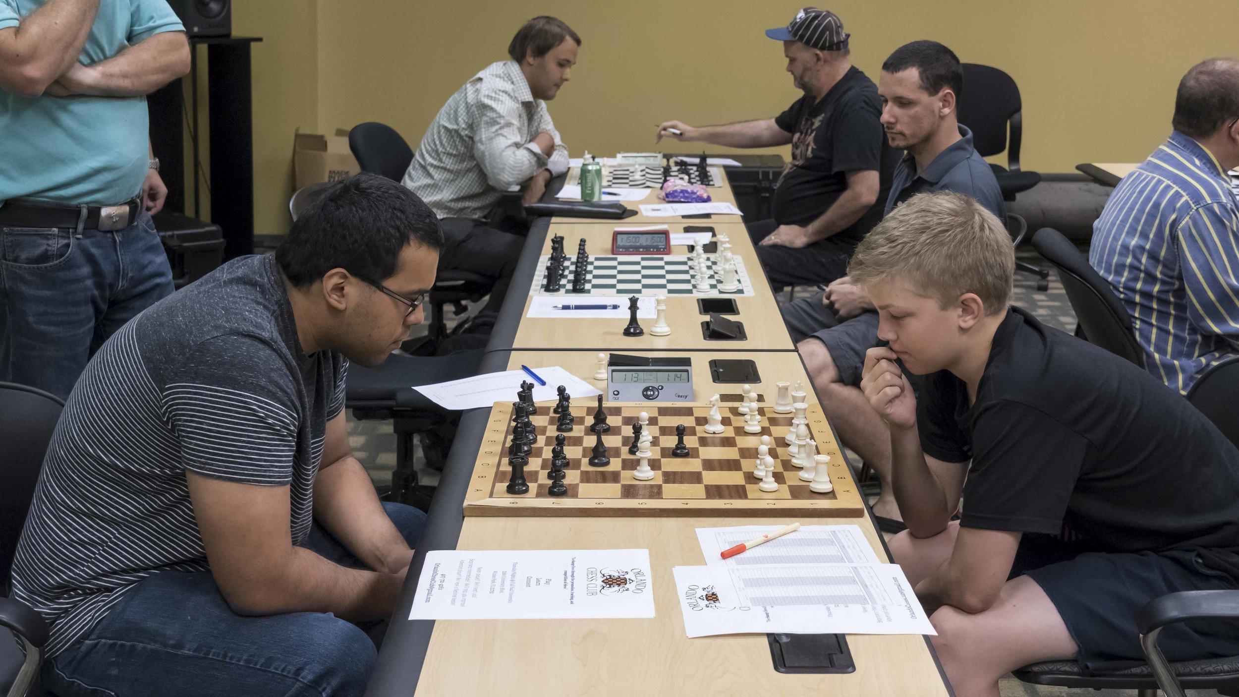 Round 2, board 1, Makaio Krienke (2176) (L) vs Gustav Hestholm (1589, FIDE) (R)