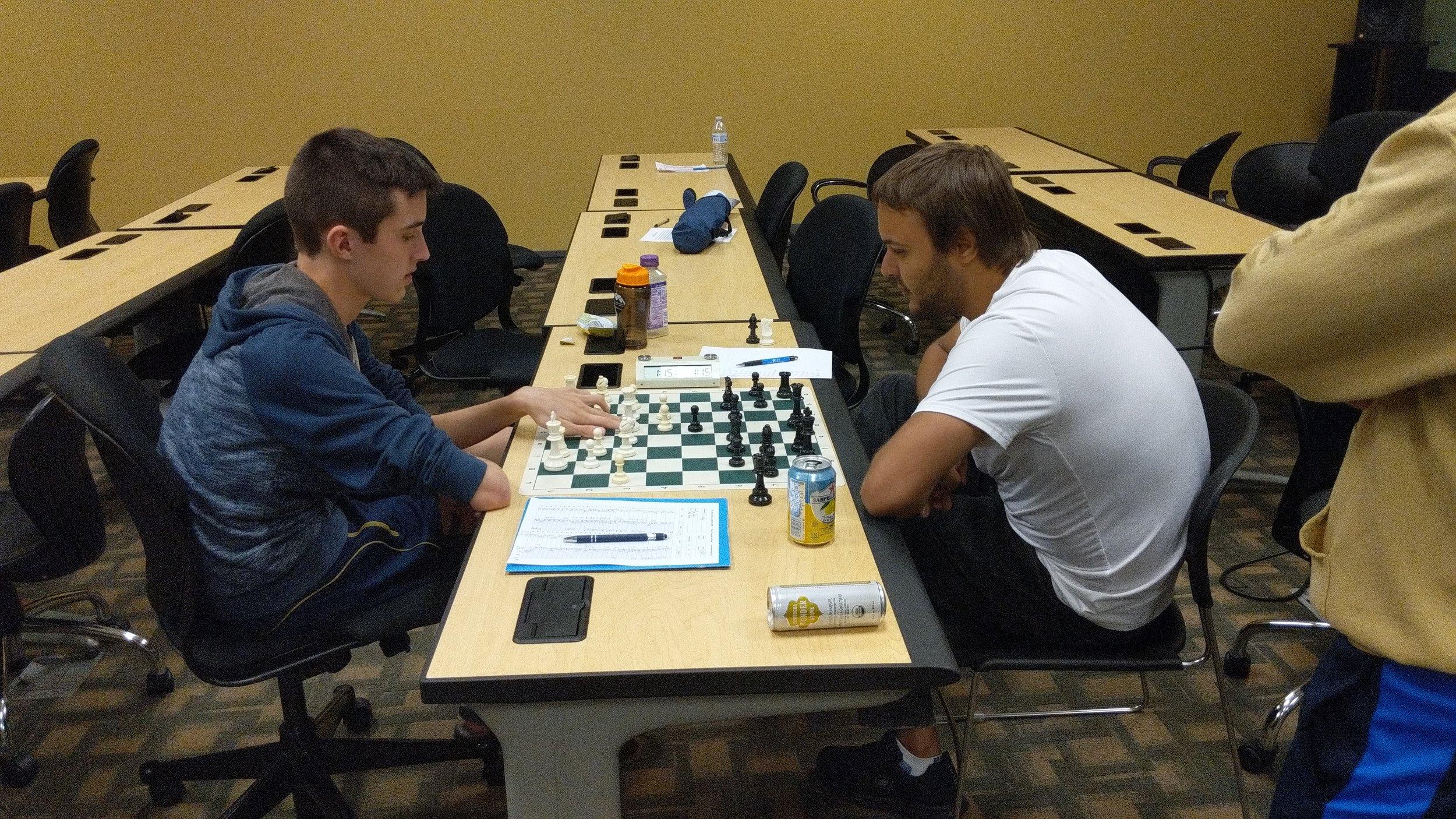 NM Theo Slade (2087, left) vs NM Martin Hansen (2212)