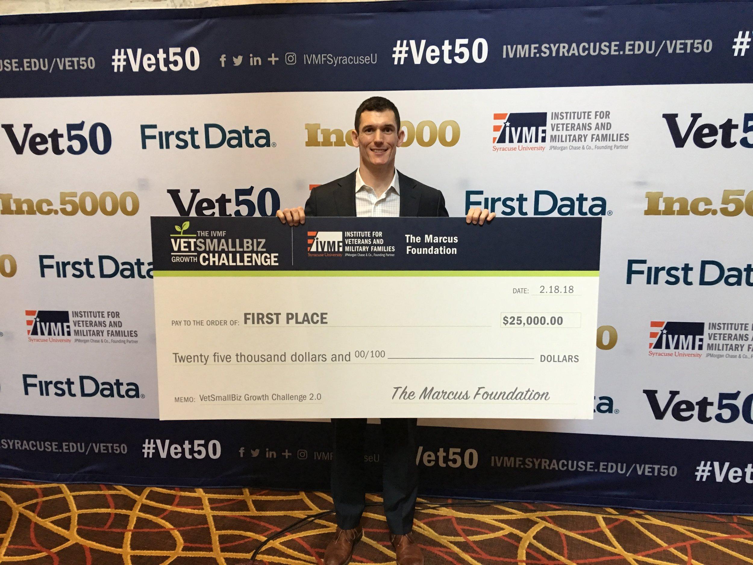 Oliver Noteware holding VetSmallBiz Growth Challenge award