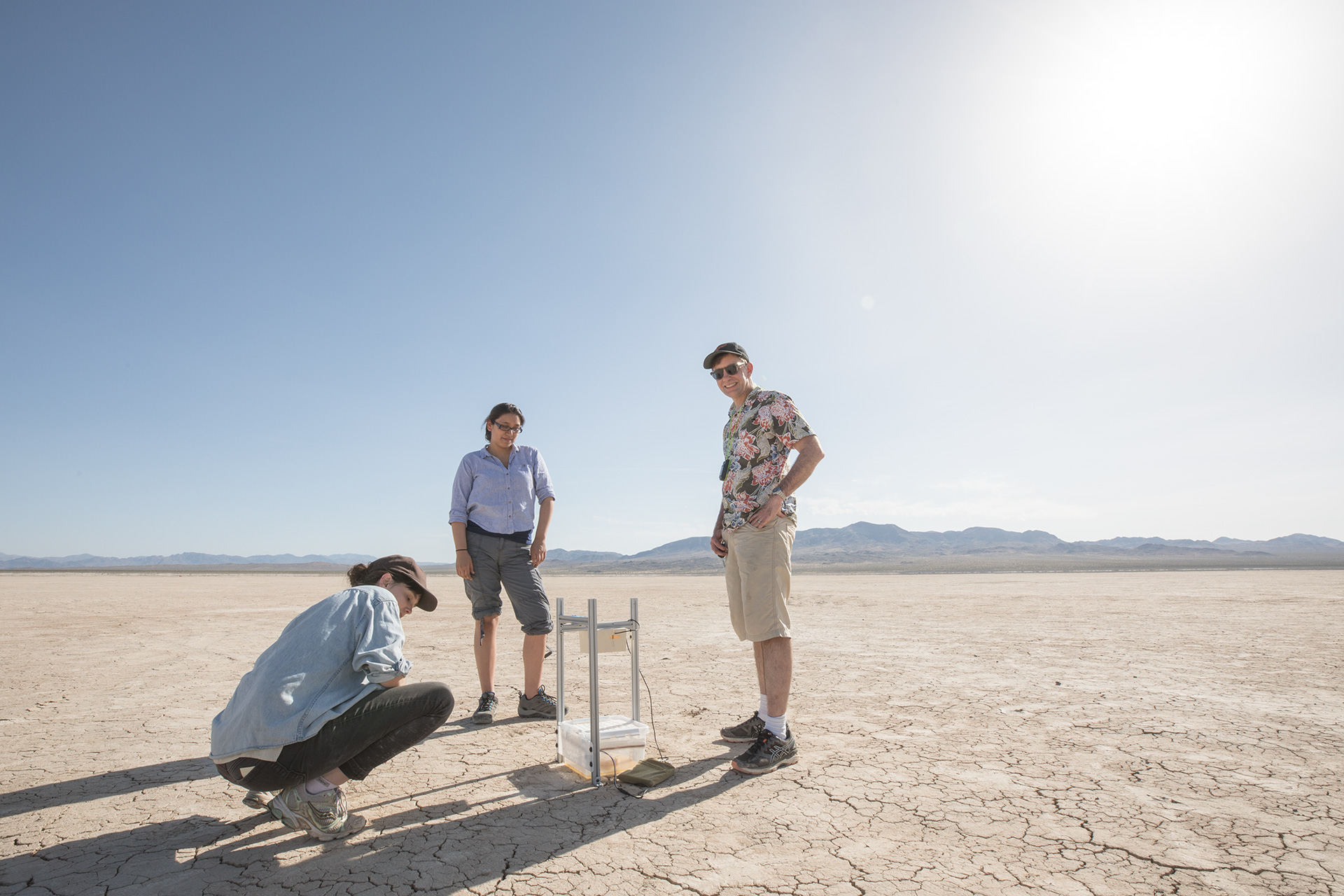 Our collaborators: Kate Leitch, Francesca Ponce, and Michael Dickinson, out on the playa, examining a fly trap.