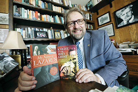 """Dale Ahlquist, president of the Society of Gilbert Keith Chesterton, holds his two recently published books, """"My Name is Lazarus"""" and """"Knight of the Holy Ghost."""" DAVE HRBACEK 