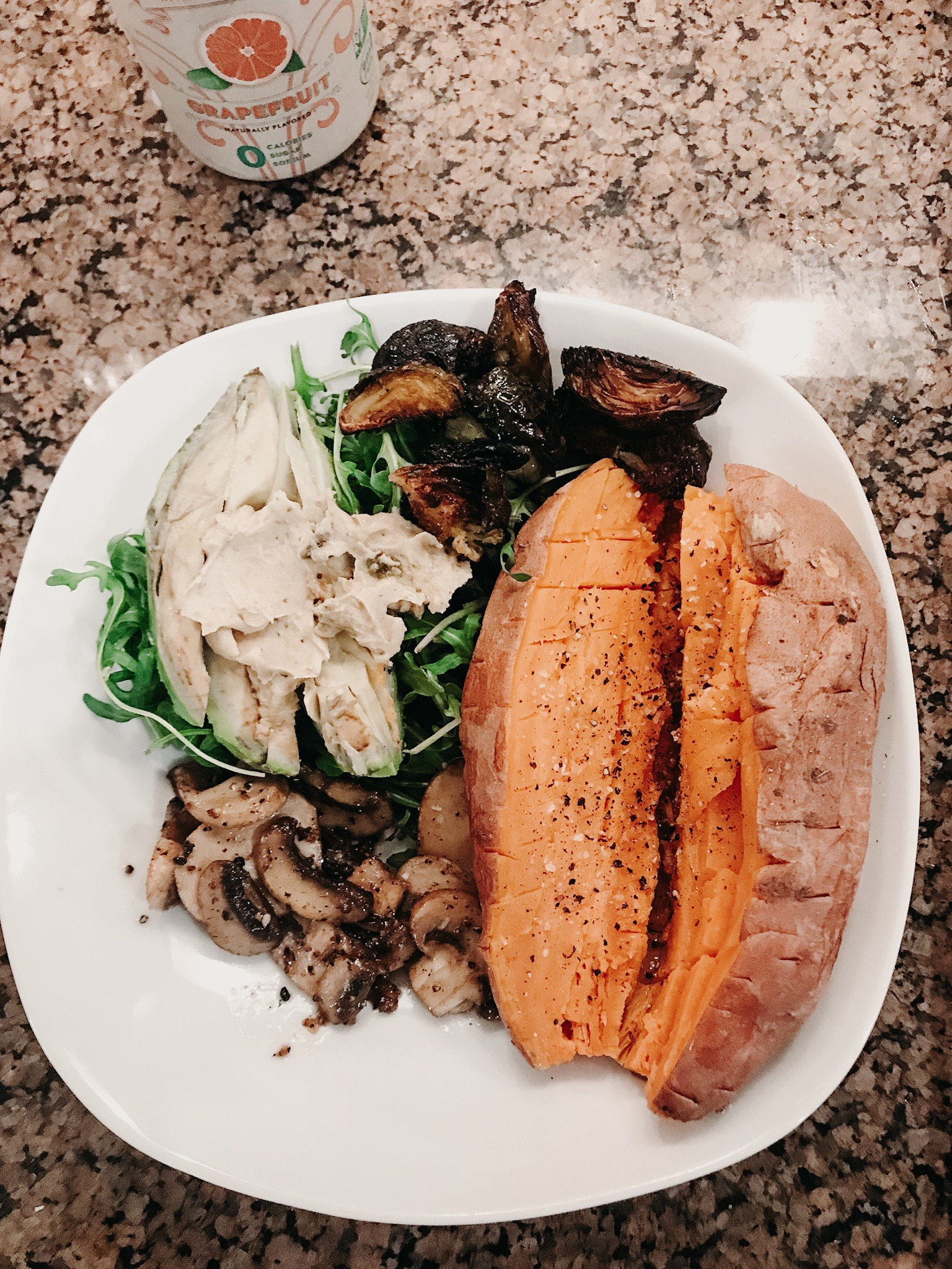 the hippie veggie bowl - + baked sweet potato with salt and pepper+ arugula + avocado+ mushrooms+ brussel sprouts+ hummus