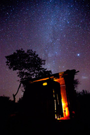 An open-fire stove burns under the stars in the hills of northern Kenya.
