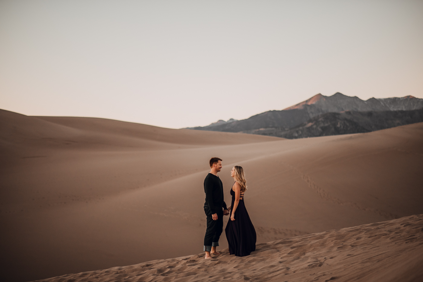 Great Sand Dunes Engagement Session PHOCO Photographer Colorado Flowy Dress Dark Moody-12.jpg