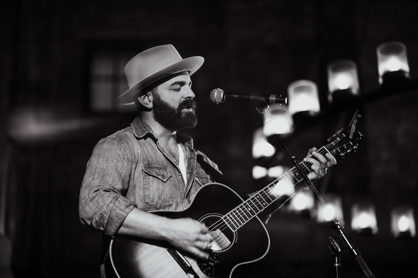 Drew Holcomb performs in the Barrel Room on Saturday afternoon.