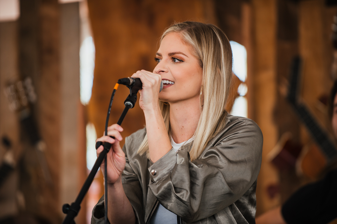 Lauren Duski, former contestant on The Voice, performs at the Bubbles Brunch