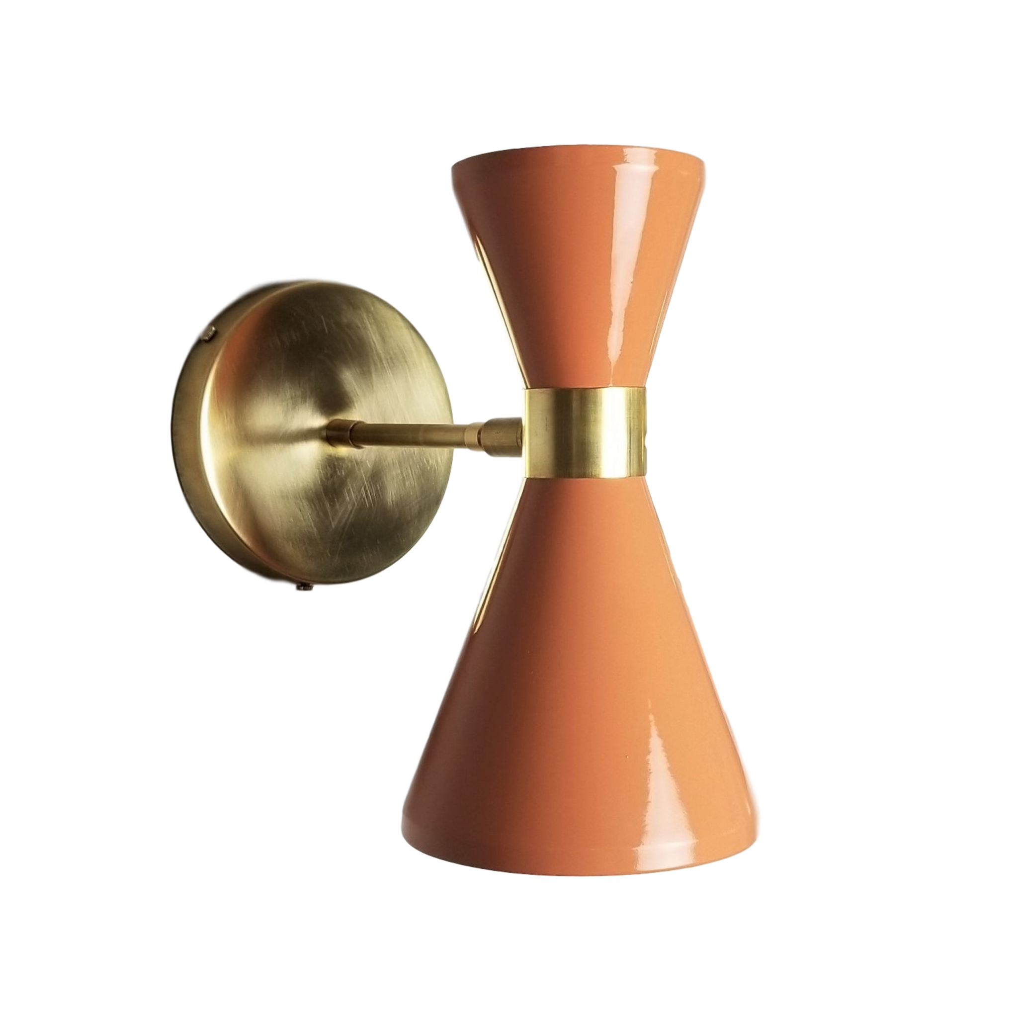 Campana Wall Sconce - $795.00Wall plug with switch(or dimmer), all metal, and articulated variants are available. Please inquire about these options.As Shown: Natural Brass and Mannequin.