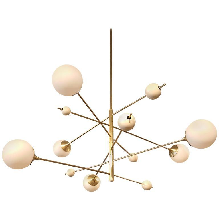 Orbital 6 Tier - $6700.00As Shown: Natural Brass and Frosted Globes.Available in any metal or enamel finish or with clear globes.