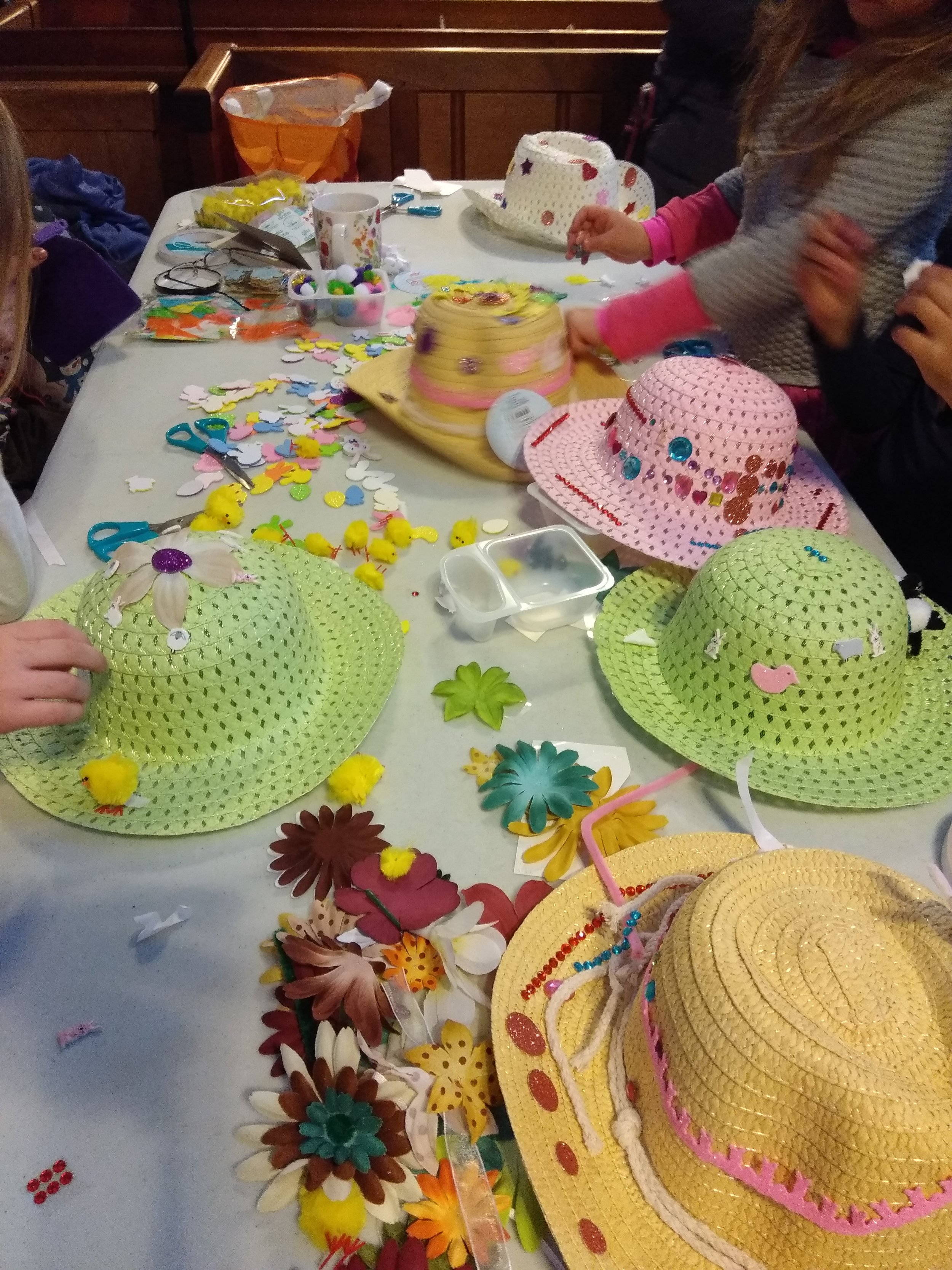 Creating Easter Bonnets during March Messy Church!