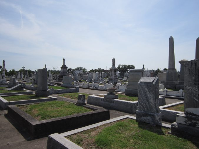 Raised grave sites and paved pathways.