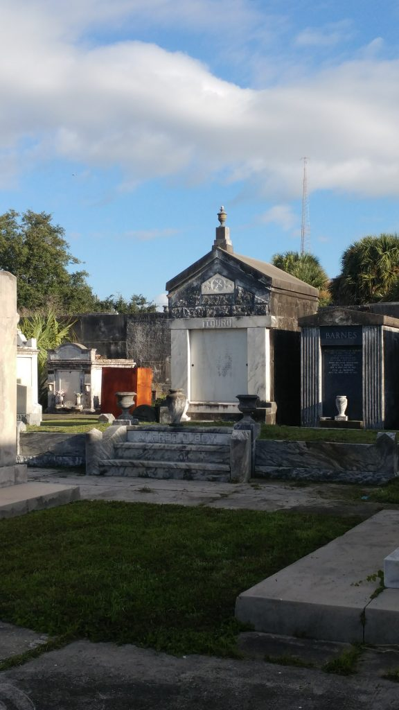 The raised Touro family tomb looms over a grassy plot