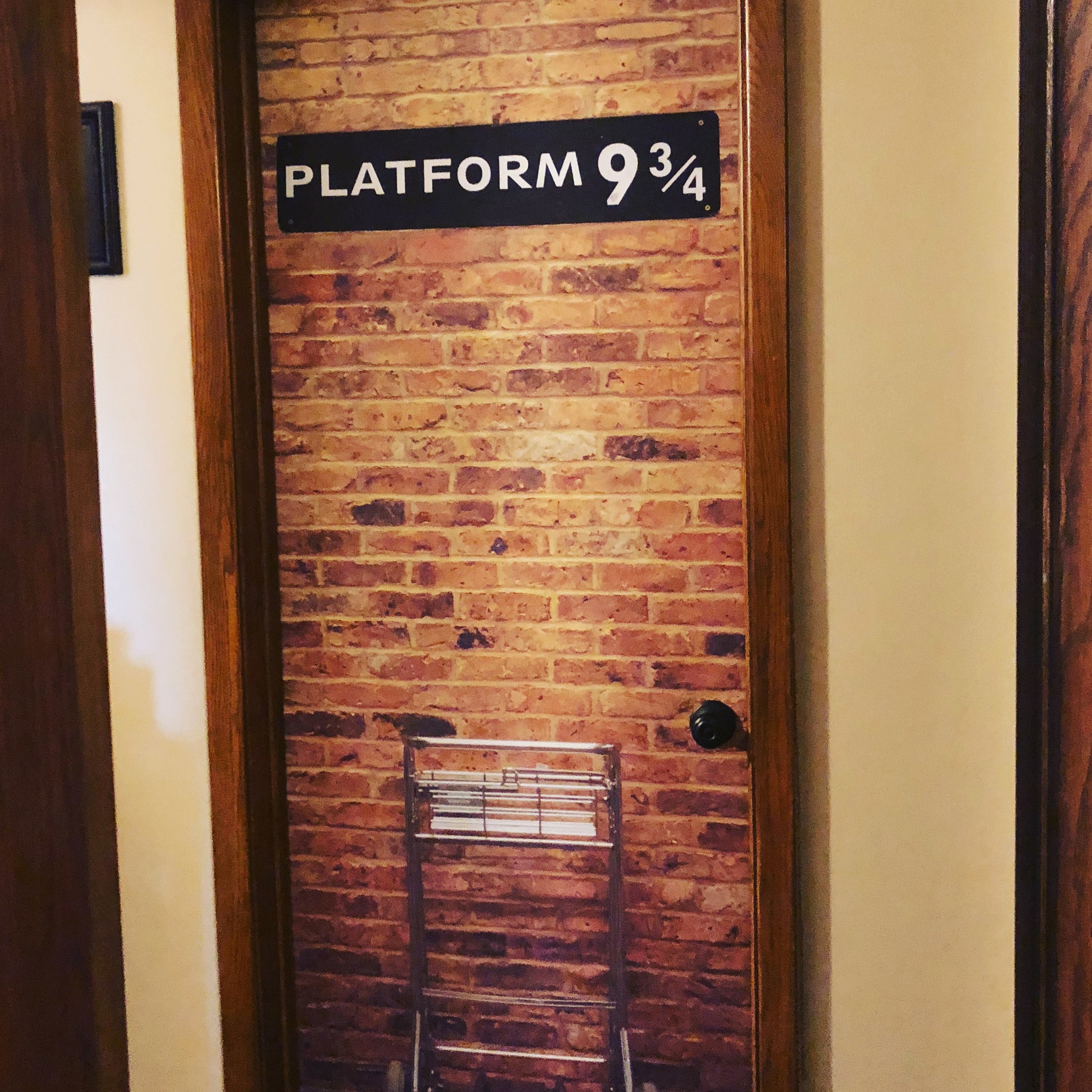 1 - I'm a #potterhead and truly believe the Harry Potter Series saved my life! I have an entire room decorated with Harry Potter memorabilia, colors and more. This is the magical doorway to said room!