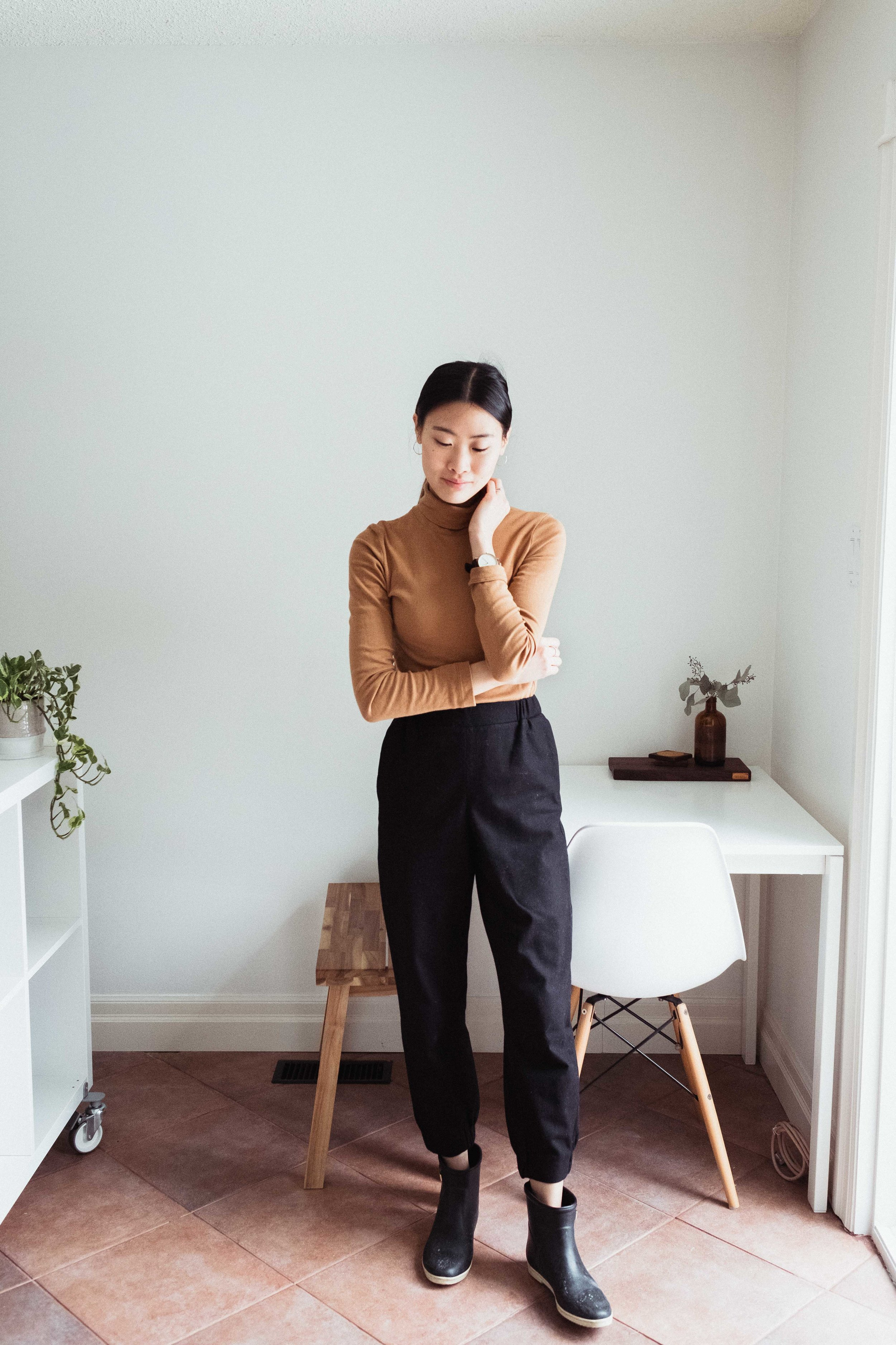 An outfit featuring an organic cotton turtleneck by  Kotn  and wool trousers by COS. See more on wool below!