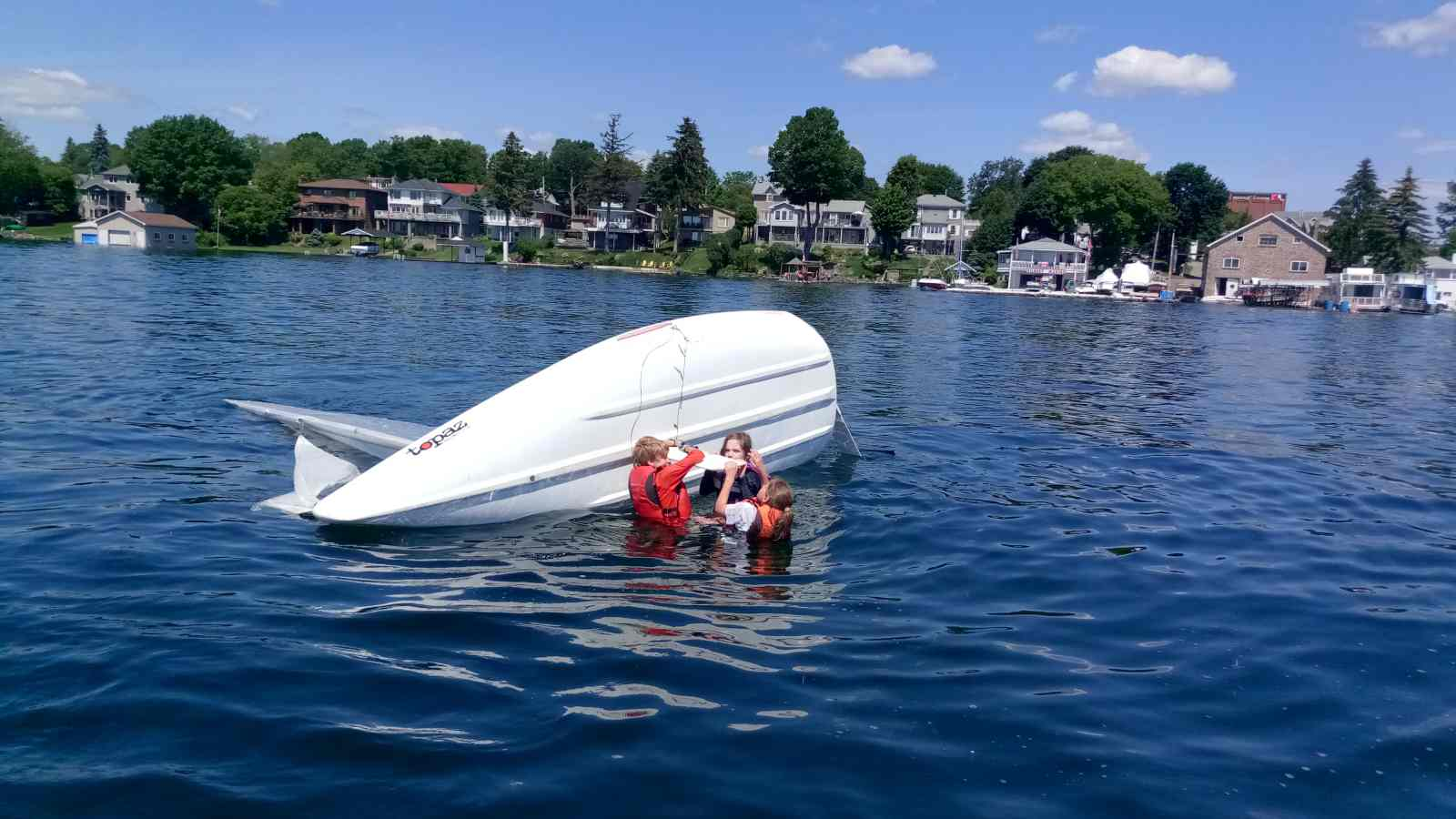Brockville Yacht Club Sailing School righting capsized boat.jpg